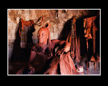 Himba women in her hut - smoking furs